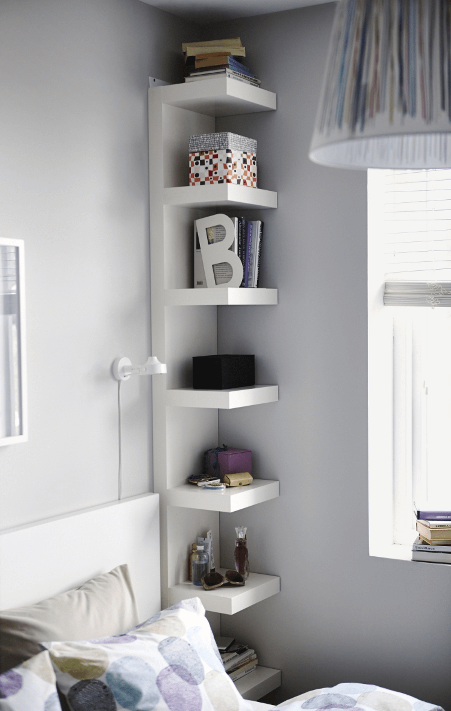 small bedroom storage ideas - use a floor-to-ceiling shelving unit