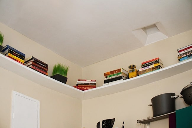small bedroom storage ideas - build shelves on the ceiling