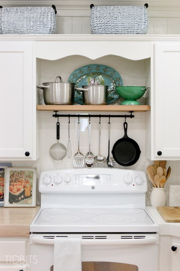 Store your pots, pans and cooking utensils above the stovetop.