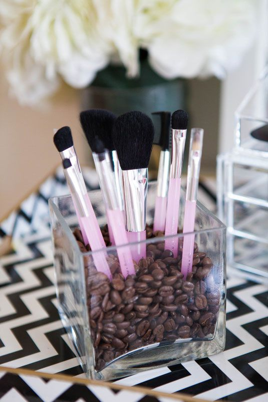Another is a simple flower vase that you can re-purpose as a makeup brush holder. Just stuff some coffee beans inside.