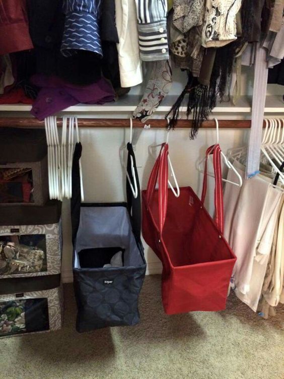 small bedroom storage ideas - Keep things off the floor by using utility bags