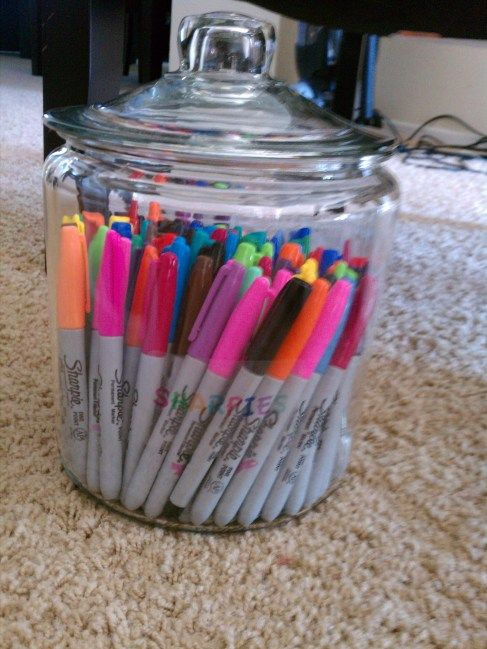 organize craft room - colored pens in a glass jar