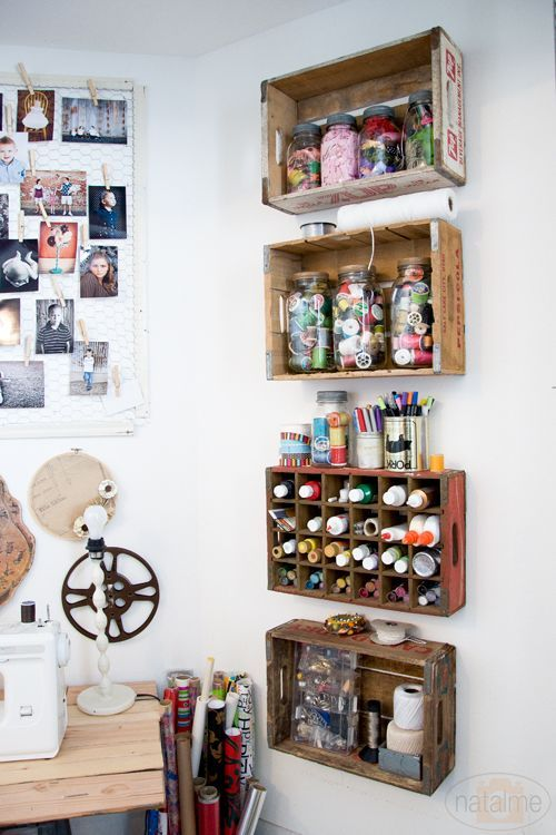 organize craft room - crates attached on walls