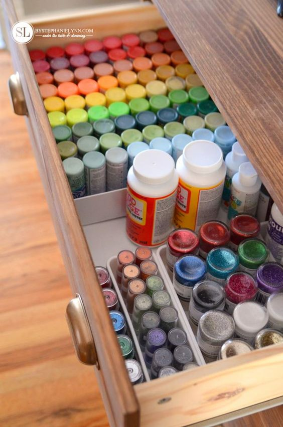 organize craft room - paints in dresser drawer