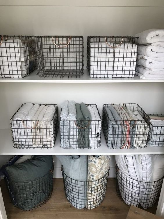 wire baskets for storage - organizing linen closet
