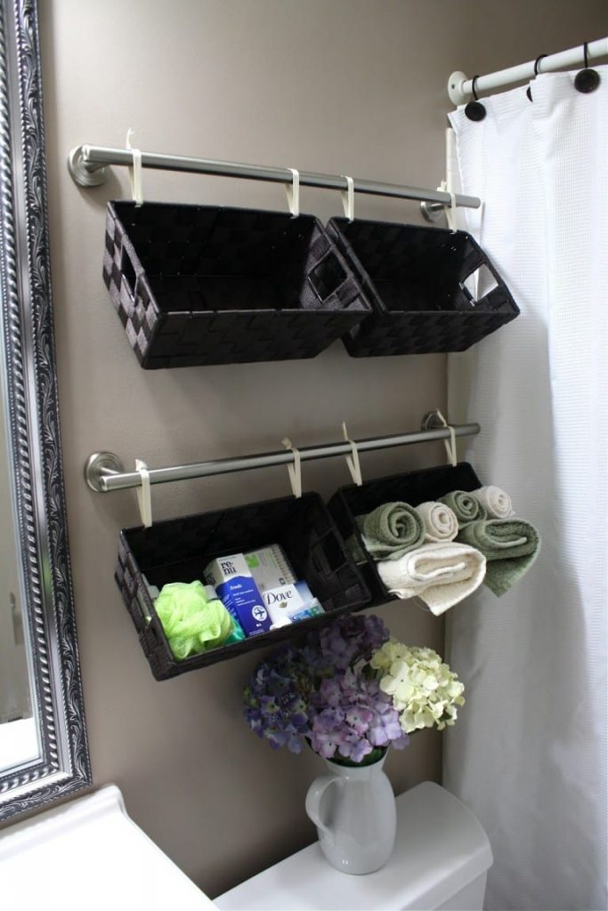 organize bathroom using baskets