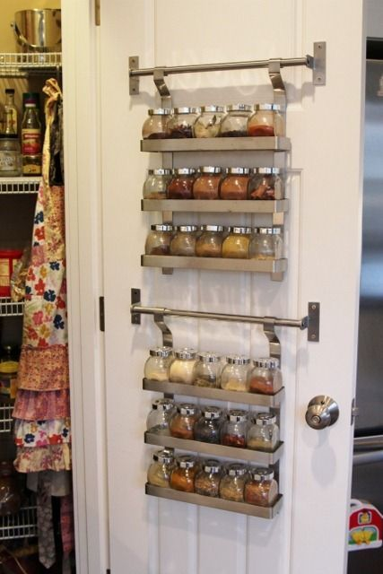 spice rack organization behind the pantry's door