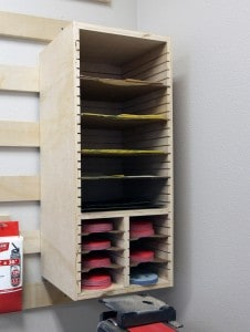a shelf customized for sandpapers