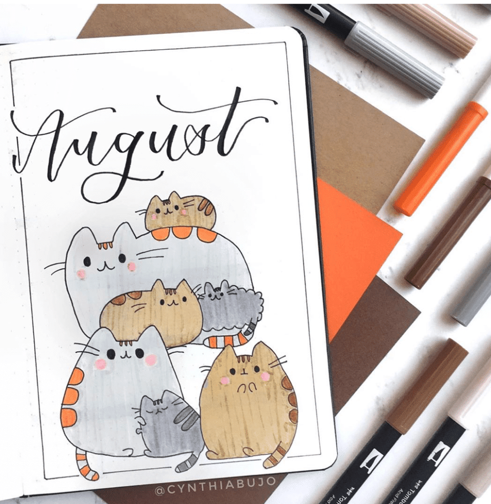 bullet journal monthly themes - cats monthly cover page