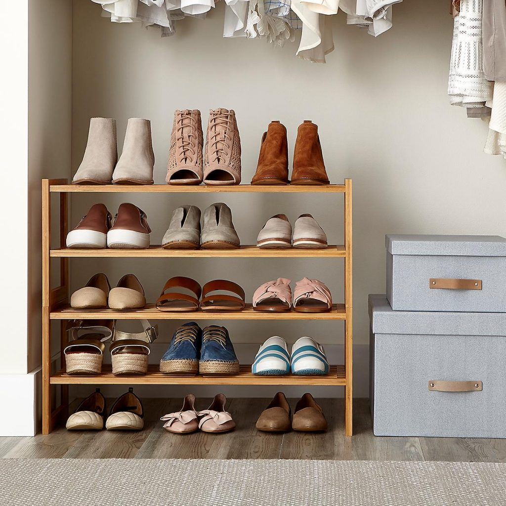 how to store shoes in the closet - Insert a small shoe rack beneath your closet