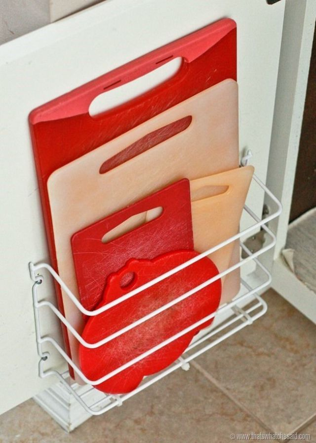 organization ideas for the kitchen - put cutting boards behind a cabinet door